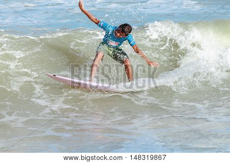 Cabedelo Paraiba Brazil - September 18 2016 - Child surfs in Intermares Beach