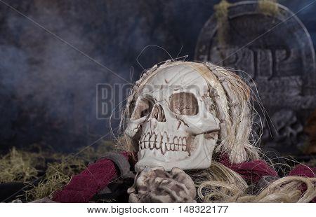 Grim reaper skull in a halloween graveyard
