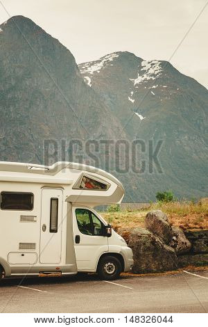 Tourism vacation and travel. Camper van and mountains landscape in Norway poster