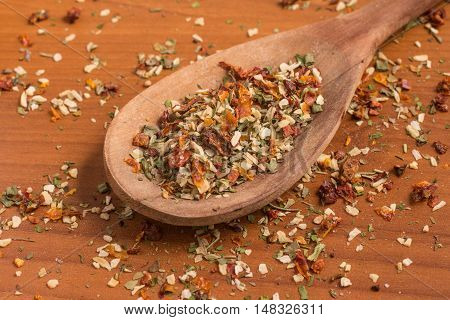 Chimichurri Herbs into a spoon over a wooden table