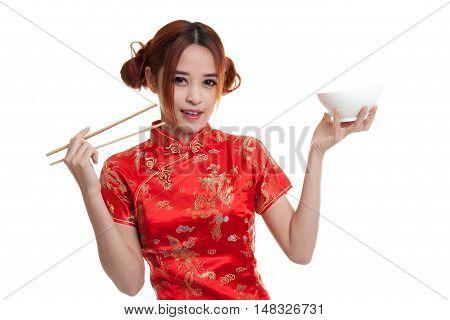 Asian Girl In Chinese Cheongsam Dress With  Chopsticks.