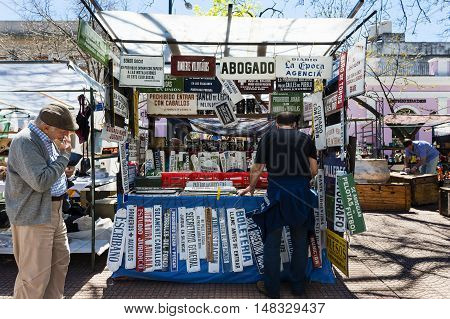 Buenos Aires Argentina - October 6 2013: People in a street market in the San Telmo neighborhood in the city of Buenos Aires in Argentina