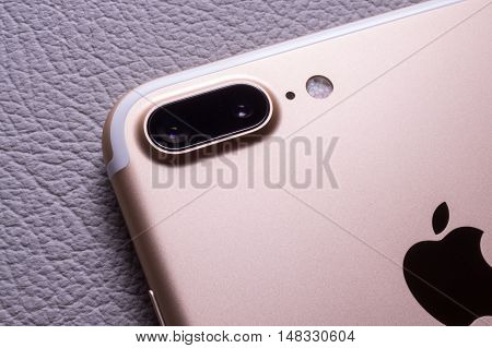 PARIS FRANCE - SEP 16 2016: New Apple iPhone 7 Plus unboxing in the first day of sales - two camera lens rear view on colorful background. New Apple iPhone acclaims to become the most popular smart phone in the world in 2016