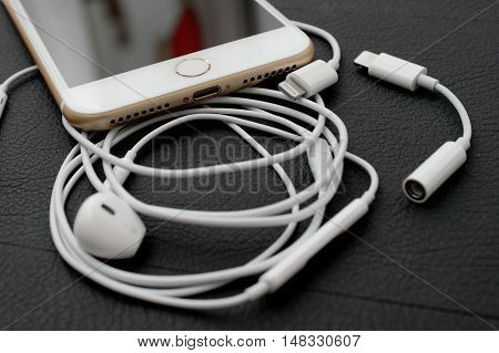 PARIS FRANCE - SEP 16 2016: New Apple iPhone 7 Plus unboxing in the first day of sales - Lighting audio conector and earpods. New Apple iPhone acclaims to become the most popular smart phone in the world in 2016
