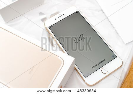 PARIS FRANCE - SEP 16 2016: New Apple iPhone 7 Plus unboxing in the first day of sales - Hello in Asian language. New Apple iPhone acclaims to become the most popular smart phone in the world in 2016