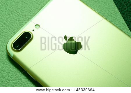 PARIS, FRANCE - SEP 16 2016: New Apple iPhone 7 Plus unboxing in the first day of sales - two camera lens rear view on colorful background. New Apple iPhone acclaims to become the most popular smart phone in the world in 2016