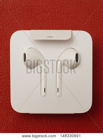 PARIS FRANCE - SEP 16 2016: New Apple iPhone 7 Plus unboxing in the first day of sales - New Apple Earpods Airpods in box. New Apple iPhone acclaims to become the most popular smart phone in the world in 2016