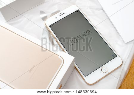 PARIS FRANCE - SEP 16 2016: New Apple iPhone 7 Plus unboxing in the first day of sales - first run hello message. New Apple iPhone acclaims to become the most popular smart phone in the world in 2016