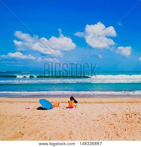 Woman on the beach in Kuta Bali Indonesia