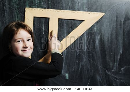 happy school girl on math classes finding solution and solving problems happy young school girl portrait on math class