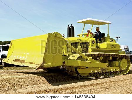 ROLLAG, MINNESOTA, Sept 1. 2016: Two unidentified men operate an old restored Euclid TC-12 bulldozer in a parade at the West Central Steam Threshers Reunion in Rollag, MN attended by 1000's held annually on Labor Day weekend.