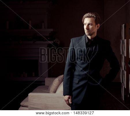 Fashion young man in luxury modern interior