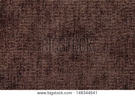 Dark brown background from a soft textile material. sheathing fabric with natural texture. Cloth backdrop.
