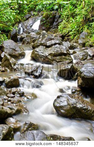 Waterfall runoff from Waimoku Falls in Hana, Maui