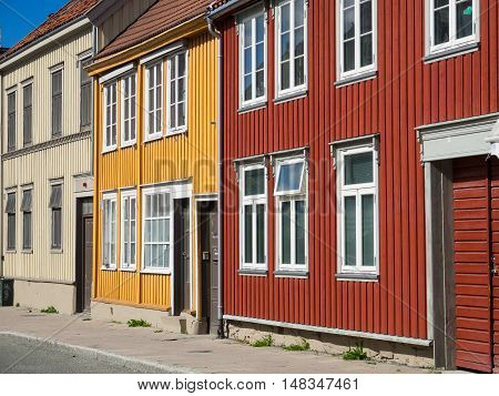 Traditional wooden Norwegian townhouses in the city of Trondheim Norway.