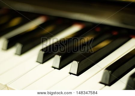 Close-up piano keys background with selective focus.