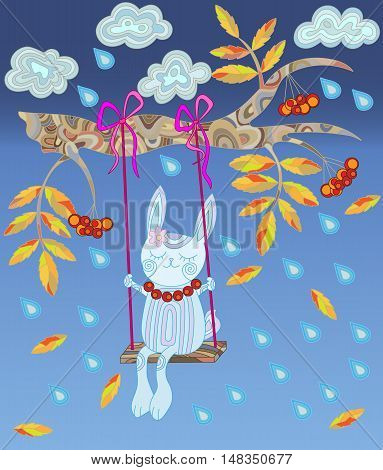 Bunny swinging on a swing on a branch of rowan tree in the rain and leaf fall