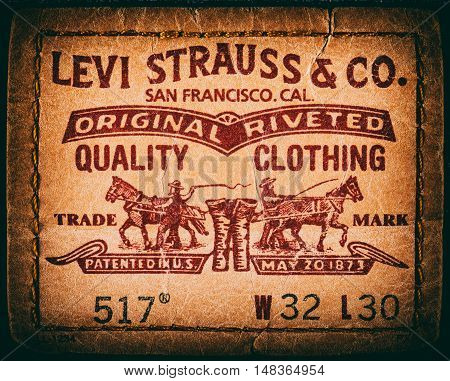 Estonia, Tallinn, December 21, 2015. Levis jeans label. Selective focus. Retro style toned image