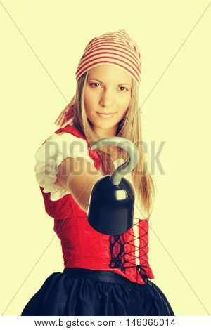 Woman wearing halloween pirate costume and hook