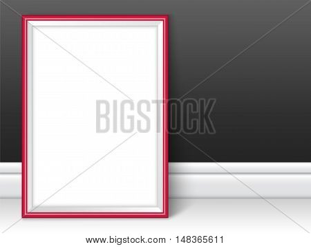 Photoframe template. Red picture framing mockup. Frame near the black wall on the floor with realistic shadows. Vector template for presentation your photo art or other crafts.