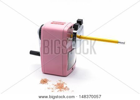 Pencil sharpener Sharpening pencil and wood shavings on a white background .