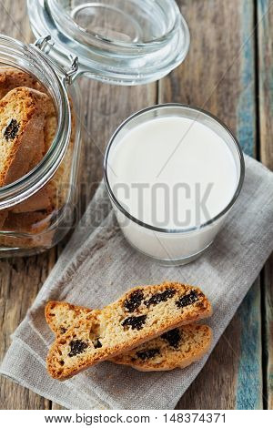 Biscotti or cantucci with raisins on wooden rustic table, traditional Italian biscuit or cookie.