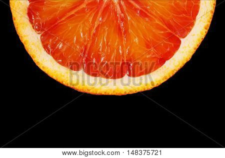 Slice red orange closeup on black background this clipping path. Washington Sanguine blood orange.