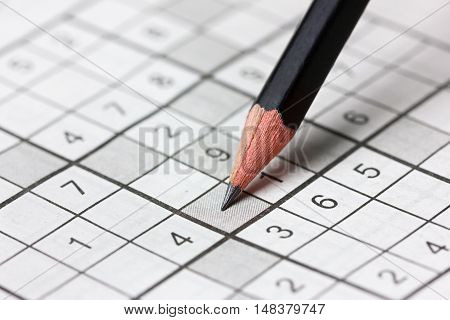 Сrossword sudoku and pencil popular puzzle game with numbers.
