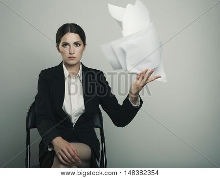 Executive Lady Elegantly Dressed Throw A Stack Of Papers To The Camera Isolated On Gray Bg