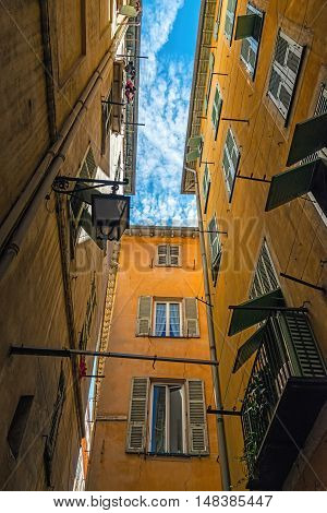 Narrow street in old part of Nice - one of the most popular cities in France