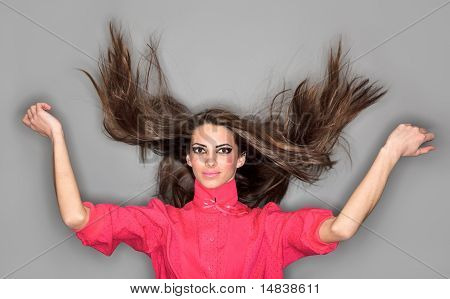 Young Cute Woman With Long Hairs Flying Upwards Dressed In Pink Blouse, Ring Flash Studio Portrait O