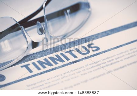 Tinnitus - Medicine Concept on Blue Background with Blurred Text and Composition of Specs. Tinnitus - Medicine Concept with Blurred Text and Glasses on Blue Background. Selective Focus. 3D Rendering.