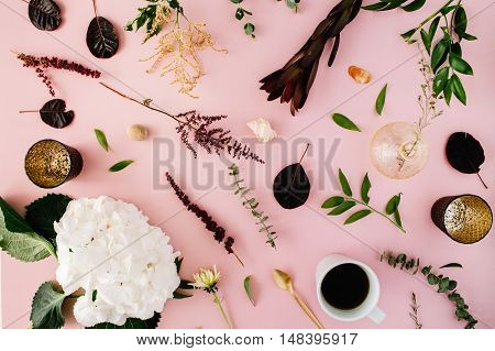 creative decorated and arranged flat lay concept with hydrangea shells coffee golden spoon branches on pink background. top view