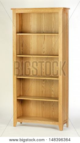 Tall wooden bookcase on a white background