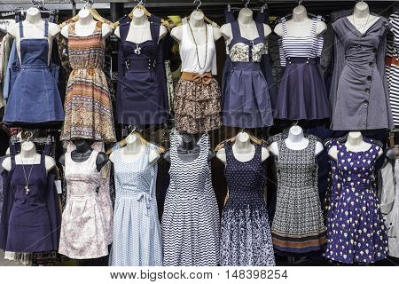 A selection of dresses on sale on a market stall on dummys