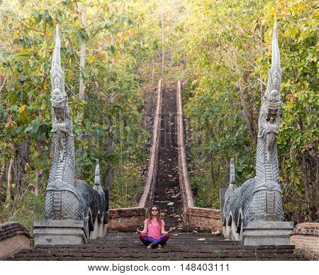 Backpacker traveling with backpack and looks at Buddhist stupas. Myanmar.
