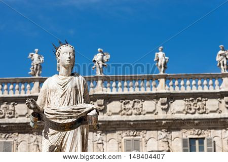Detail of the fountain in Piazza delle Erbe with the statue of Madonna Verona in Verona (UNESCO world heritage site) Veneto Italy