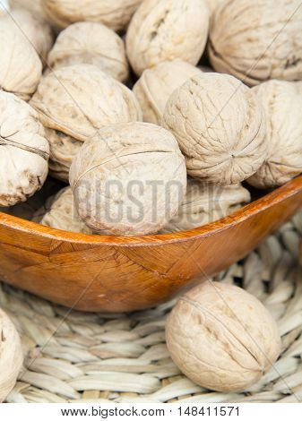closup of a walnuts in a bowl - tasty fruits