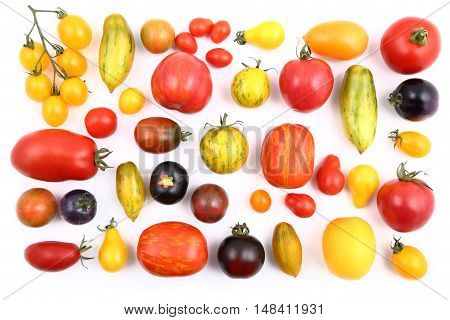 Colorful different kind tomatoes on white background.