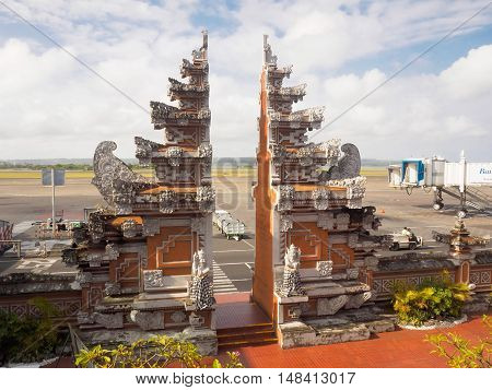 Bali Indonesia - September 18 2016: The Balinese traditional gate from the apron to the arrival terminal of Denpasar International airport also known as Bali Ngurah Rai International Airport Bali island Indonesia.