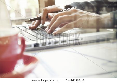 Business Woman's Hands Typing On Laptop Keyboard.