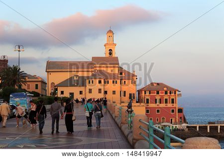 Genoa, Italy - June 25, 2016: Main promenade Corso Italia and church St. Anthony at sunset. The church was built in the 17th century in the neighbourhood Boccadasse.