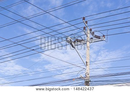 The eleectricity pole with the electric line with the sky.The communication line and electric line share the same pole.