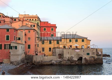 Genoa, Italy - June 25, 2016: Restaurant right beside Mediterranean Sea in Boccadasse. Boccadasse is an old mariners neighbourhood of Genoa and a tourist attraction.