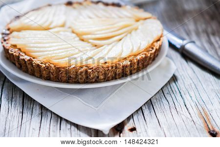 Healthy Pear Tart/ Vegan Dessert on Wood Background, Selective Focus, close up.