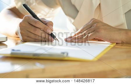 Asian Business Woman Signing A Contract Document