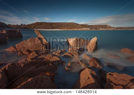 View of Pwll Du Bay from the headland, on the Gower peninsula in South Wales, mainly covered in pebbles, used to be an extensive limestone quarry and also a popular smuggling cove.