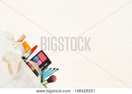 Set of colorful cosmetics on White wood texture of wooden boards floor