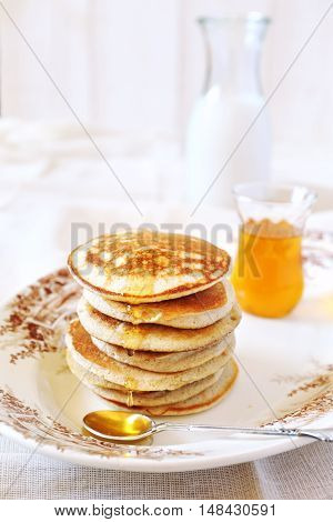 Pancake with honey and milk for breakfast