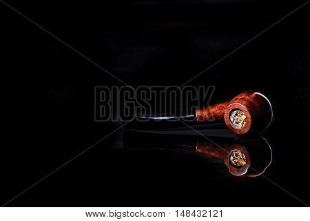 Brier smoking pipe with reflection isolated on black background